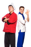 Team of two men, chefs, cooks Stock Photography