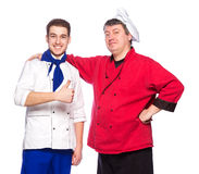 Team of two men, chefs, cooks Stock Images