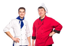 Team of two men, chefs, cooks. Isolated on white background Royalty Free Stock Photo