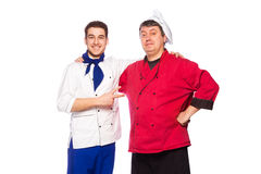 Team of two men, chefs, cooks. Isolated on white background Stock Photos