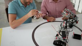 Team of two professional chatting about robotics. Two heads are better than one. Two male colleagues having a friendly conversation while talking about stock video