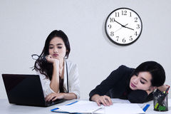 Team of two tired businesswoman Stock Image