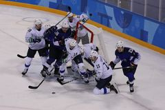 Team United States Blue in action against Team Slovenia during men`s ice hockey preliminary round game at 2018 Winter Olympics Royalty Free Stock Photos
