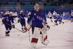 Team United States during warm up before the men`s ice hockey preliminary round game against Team Slovenia at 2018 Winter Olympics Royalty Free Stock Photo