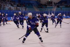 Team United States during warm up before the men`s ice hockey preliminary round game against Team Slovenia at 2018 Winter Olympics Royalty Free Stock Photos