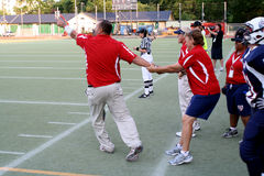 Team USA Woman's Football Coach Held Back at Game Stock Photography