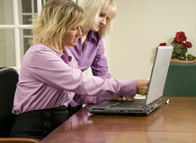 Businesswomen with laptop Stock Image
