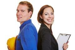 Team van arbeider en bedrijfsvrouw Stock Foto