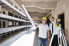 Team van architecten op construcitonplaats Stock Fotografie