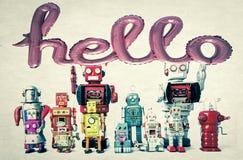 Team van retro robots een baloon hello stock afbeelding