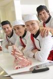 Team van studenten in slachterij Stock Afbeeldingen