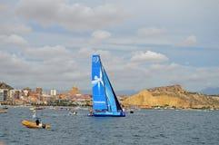 Team Vestas Wind Surrounded By små fartyg Royaltyfri Fotografi