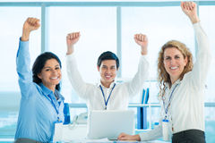 Team victory. Portrait of a multi-ethnic team celebrating their business victory Stock Photo