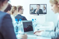 Team during video conference stock images
