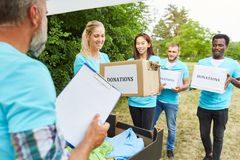 Team volunteer collects donations in boxes royalty free stock photography