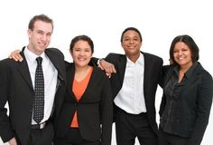 Team of volunteers. Group of four confident happy people in a team environment, conceptual volunteering or business concept royalty free stock photography