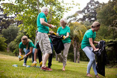 Team of volunteers picking up litter. In park Royalty Free Stock Photos