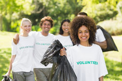 Team of volunteers picking up litter in park Stock Photo