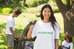 Team of volunteers picking up litter in park Royalty Free Stock Image