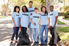 Team Of Volunteers Picking Up Litter In Suburban Street Stock Photography