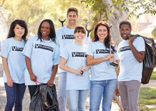 Team Of Volunteers Picking Up Litter In Suburban Street Royalty Free Stock Photos