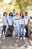 Team Of Volunteers Picking Up Litter In Suburban Street Stock Photos