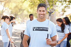 Team Of Volunteers Picking Up Litter In Suburban Street Royalty Free Stock Photography