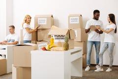 Team of volunteers preparing a large humanitarian aid shipment Royalty Free Stock Image