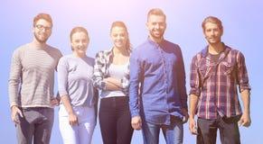 Team von überzeugten jungen Leuten Lizenzfreies Stockbild