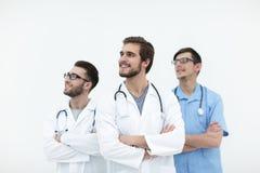 Team von Doktoren, die Kopienraum betrachten Lizenzfreies Stockbild