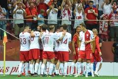 Team von Polen-Freude nach z?hlendem Ziel stockbilder