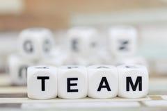 Team, Würfelbuchstaben Stockfoto