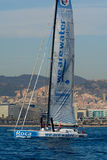 Team We Are Water.Boat and Barcelona City Background. Barcelona World Race Royalty Free Stock Photos