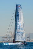 Team We Are Water.Boat and Barcelona City Background. Barcelona World Race Royalty Free Stock Photography