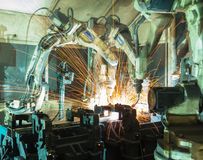 Team welding robots represent the movement Stock Photo