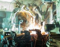 Team welding robots represent the movement Stock Photography