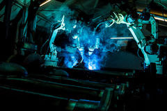 Team welding robots represent the movement. Royalty Free Stock Photos