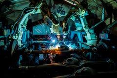 Team welding robots represent the movement. Royalty Free Stock Photo