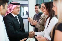 Team welkom hetende zakenman Stock Foto