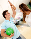 Team winning at bowling Royalty Free Stock Photography