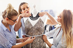 Team of women working on mannequin in atelier Royalty Free Stock Photography
