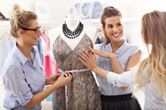 Team of women working on mannequin in atelier Royalty Free Stock Images