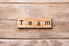 Team word written on wood block. team text on wooden table for your desing, concept stock image