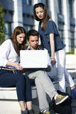 Team work. Young group of people working on laptop outside Royalty Free Stock Image