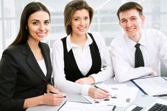 Team work. Young businessman with his collegues Royalty Free Stock Photography