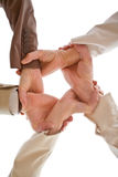 Team Work. Small group of business people joining hands, low angle view