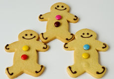 Team work. Three shortbread figures demonstrate team work stock photography