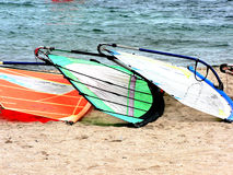Team work. Three colorful windsurf left on the beach after a hard day of training Royalty Free Stock Photo