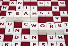 Team work. A word game spelling out the words team work among many letters Royalty Free Stock Photos