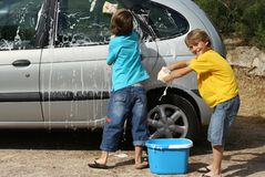 Team work. Children washing car Stock Photography